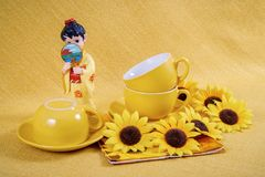 Coffee cups and saucers  and figurine geisha Stock Image