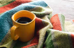 Coffee cups and scarves on a wooden table Stock Image