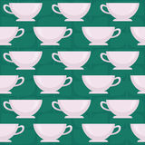 Coffee cups. Seamless vector pattern on green background Royalty Free Stock Photography