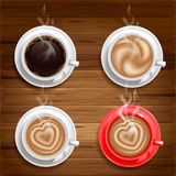 Coffee cups. Set of four coffee cups on wooden background. Vector Stock Images