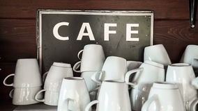 Coffee cups with sign in cafe stock video footage
