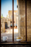 2 coffee cups. Sitting on a low wall (Cyprus Stock Images