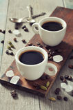 Coffee in cups with spices Stock Photos