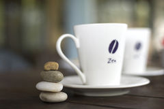 Coffee cups. On the table with stones Royalty Free Stock Photo