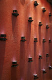 Coffee Cups on wall. Decoration of coffee / tea cups on red wall of cafe Stock Image