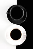 Coffee cups on white and black Stock Photography