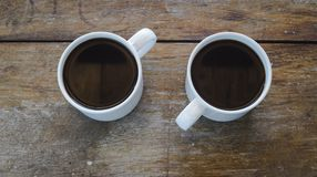 Coffee cups. On wooden board Stock Photo