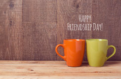 Coffee cups on wooden table. Friendship day celebration. Concept stock photography