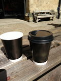 Coffee cups. On wooden table outdoor Royalty Free Stock Photos
