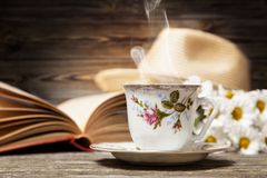 Coffee, daisies and a book Royalty Free Stock Photo
