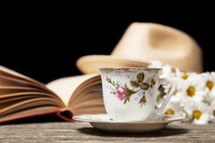 Coffee, daisies and a book Stock Photography