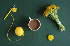 Coffee, dandelions and crocheted flower Stock Photos