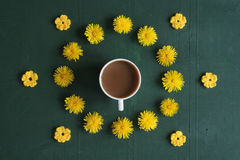 Coffee, dandelions and crocheted flowers Stock Photography