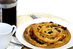 Coffee and Danish pastry on white ground Royalty Free Stock Photo