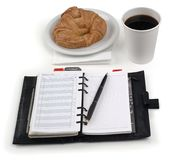 Coffee, danish, planner. Coffee, croissant & daily planner on white - with clipping path Royalty Free Stock Image