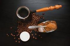 Coffee On Dark Background. Ground Coffee, The Coffee Pot And Coffee Beans On Dark Background Stock Photos