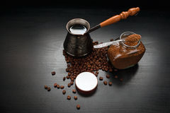 Coffee On Dark Background. Ground Coffee, The Coffee Pot And Coffee Beans On Dark Background Royalty Free Stock Image