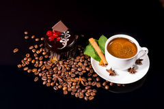 Coffee with Dark Chocolate Cake and Roasted Beans. High Angle Still Life View of Frothy Gourmet Espresso Coffee Garnished with Fresh Mint Leaves, Cinnamon Stick Stock Image
