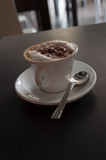 Coffee on the dark desk Stock Photography