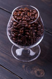 Coffee on dark wood Stock Photography