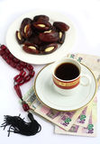 Coffee dates worry beads arab money. Coffee, Arabian high-value bank notes, stuffed dates and worry beads - the essentials for doing business in the arab world Stock Photo