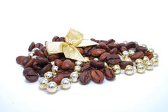 Coffee with decoration. Coffee beans and gold decorations isolated royalty free stock photos