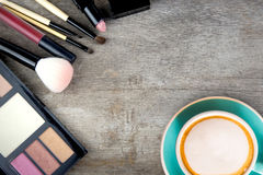 Coffee and decorative cosmetics on table. Coffee and decorative cosmetics on a wooden table Royalty Free Stock Photography
