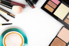 Coffee and decorative cosmetics on white. Coffee and decorative cosmetics on white background Stock Photography