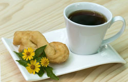 Coffee with deep-fried doughstick. Breakfast Royalty Free Stock Image