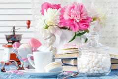 Coffee and delicate bouquet of peonies Stock Photo