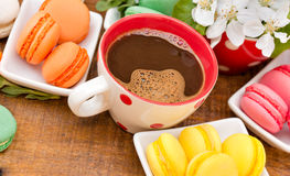 Coffee and delicious colourful macaroons - macarons Royalty Free Stock Images