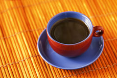 Coffee delight. A vivid colored cup of breakfast coffee Stock Images