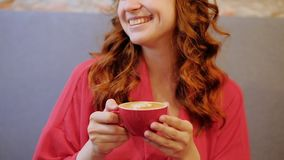 Coffee delight happy smiling woman cafe enjoy cup. Coffee delight. Young happy smiling woman in cafe enjoying her cup of latte stock video