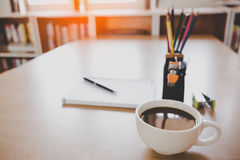 Coffee on desk of working businesspeople at meeting Stock Photo