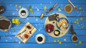Coffee and dessert on a blue wooden table. Top view. stock footage