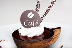 Coffee dessert with a chocolate. Stilized like a coffee cup Royalty Free Stock Photography