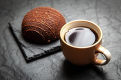 Coffee and a dessert. On a slate background stock photography