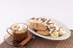 Coffee and Dessert. Coffee, cookies, banana cream and chocolate on a white background stock photos