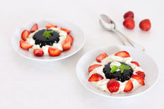 Coffee dessert with cream and strawberries Stock Photography