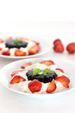 Coffee dessert with cream and strawberries Royalty Free Stock Photos