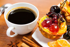 Coffee and dessert. Cup of coffee and sweet fruit cake on a table Stock Photos