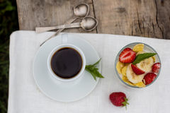 Coffee and dessert with fruits. A cup of coffee and dessert in glass on the table Stock Photo