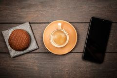 Coffee, dessert and a smartphone royalty free stock photos