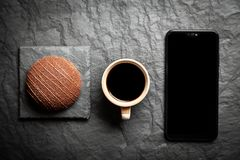 Coffee, dessert and a smartphone stock images