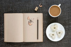 Coffee, diary, pencil and heart-shaped cookies Royalty Free Stock Photo