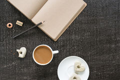 Coffee, diary, pencil and heart-shaped cookies Stock Image