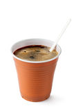Coffee in disposable cup with plastic spoon. Standing on a white Stock Photography