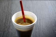 Coffee in a Disposable Cup. On a Wooden Table Royalty Free Stock Photos