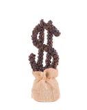 Coffee dollar growing of burlap sack. Stock Photo