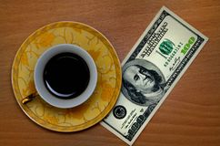 Coffee and hundred dollars Royalty Free Stock Images